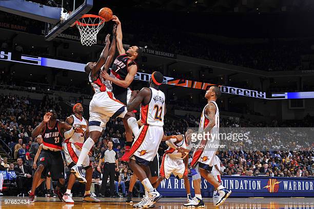 Brandon Roy of the Portland Trail Blazers is met at the rim against Anthony Tolliver of the Golden State Warriors on March 11 2010 at Oracle Arena in...