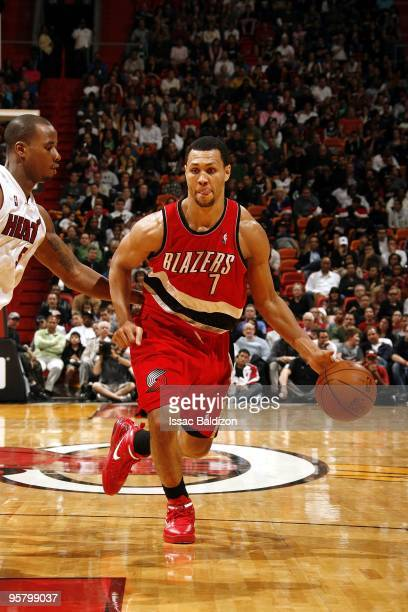 Brandon Roy of the Portland Trail Blazers moves the ball up court against Quentin Richardson of the Miami Heat during the game at American Airlines...