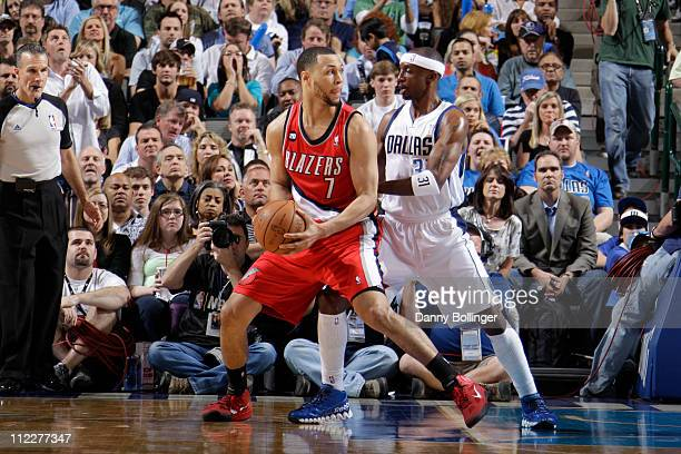 Brandon Roy of the Portland Trail Blazers posts up against Jason Terry of the Dallas Mavericks during Game One of the Western Conference...