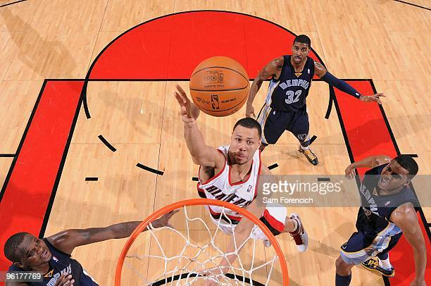 Brandon Roy of the Portland Trail Blazers puts up a shot between Zach Randolph and Rudy Gay of the Memphis Grizzlies during the game on January 5...