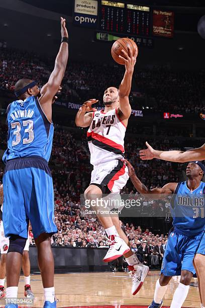 Brandon Roy of the Portland Trail Blazers shoots against Brendan Haywood of the Dallas Mavericks in Game Six of the Western Conference Quarterfinals...
