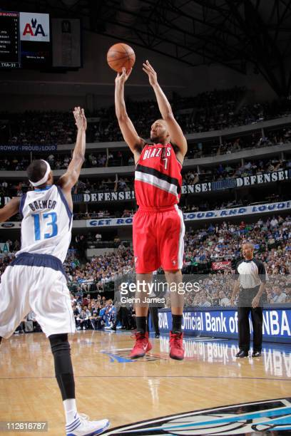 Brandon Roy of the Portland Trail Blazers shoots against Corey Brewer of the Dallas Mavericks during Game Two of the Western Conference Quarterfinals...