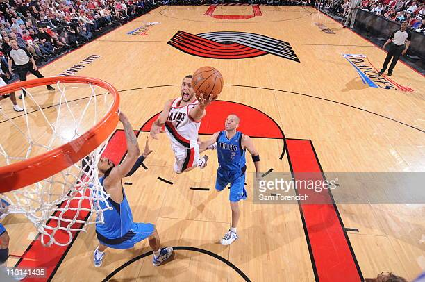 Brandon Roy of the Portland Trail Blazers shoots over Jason Kidd and Tyson Chandler of the Dallas Mavericks in Game Four of the Western Conference...