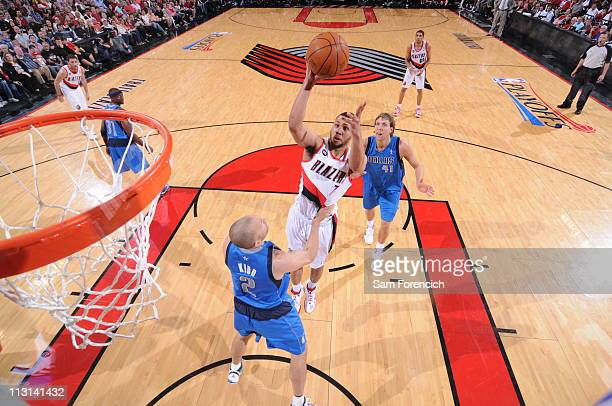 Brandon Roy of the Portland Trail Blazers shoots over Jason Kidd of the Dallas Mavericks in Game Four of the Western Conference Quarterfinals in the...