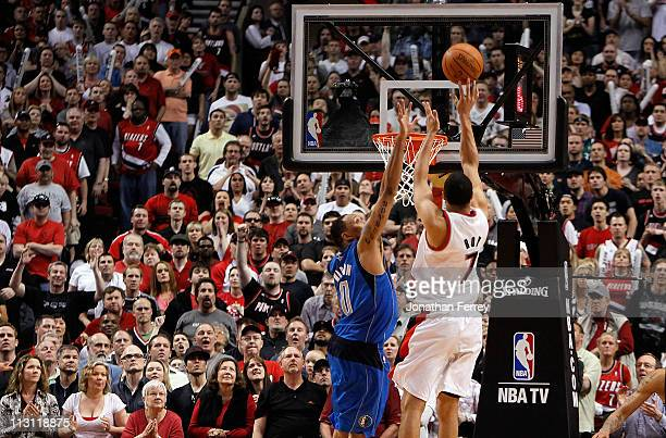 Brandon Roy of the Portland Trail Blazers shoots Shawn Marion of the Dallas Mavericks in Game Four of the Western Conference Quarterfinals in the...