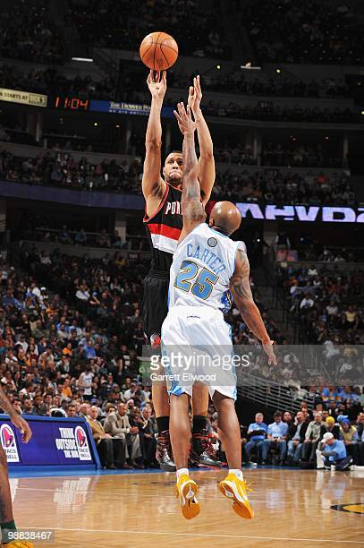 Brandon Roy of the Portland Trail Blazers takes a jump shot against Anthony Carter of the Denver Nuggets during the game on April 1 2010 at the Pepsi...