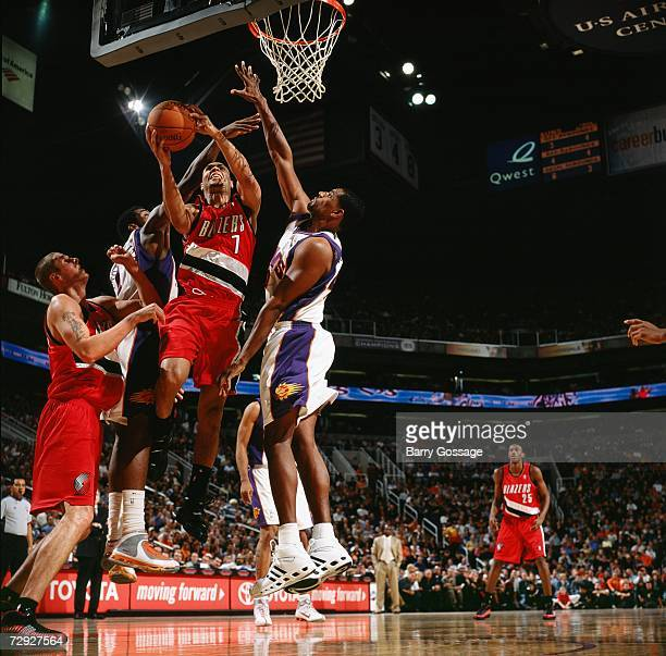 Brandon Roy of the Portland Trail Blazers takes the ball to the basket against Amare Stoudemire and Kurt Thomas of the Phoenix Suns during a game at...