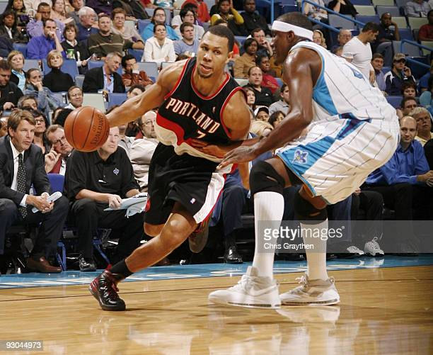 Brandon Roy of the Portland Trail drives the ball against Blazers James Posey of the New Orleans Hornets during the game at New Orleans Arena on...