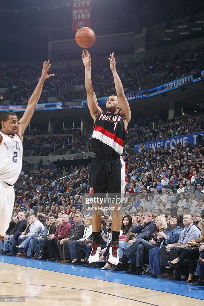 Brandon Roy #7 of the Portland Trailblazers shoots a jump shot against Thabo Sefolosha #2 of the Oklahoma City Thunder on March 28, 2010 at the Ford Center in Oklahoma City, Oklahoma.