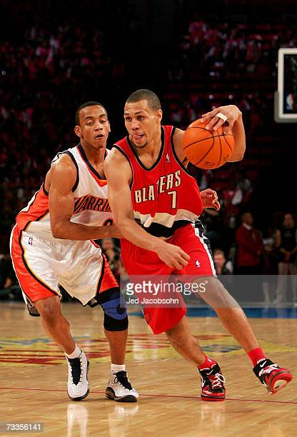 Brandon Roy of the Rookie Team handles the ball under pressure from Monta Ellis of the Sophomore Team during the TMobile Rookie Challenge at NBA...