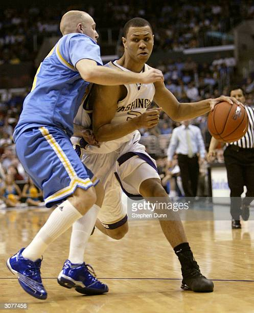 Brandon Roy of the Washington Huskies drives against Brian Morrison of the UCLA Bruins during the quarterfinals of the 2004 Pacific Life Pac10...