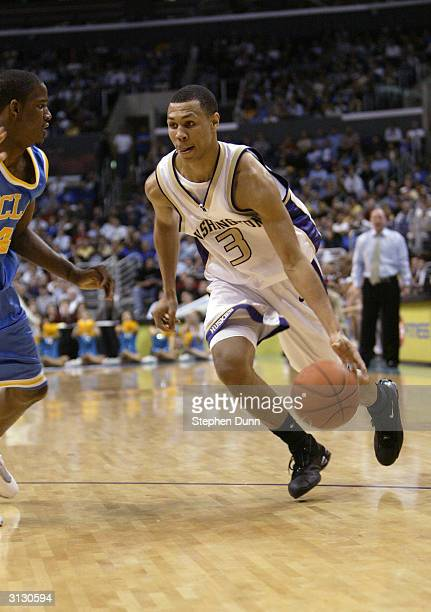 Brandon Roy of the Washington Huskies drives to the hoop against the UCLA Bruins during the quarterfinals of the 2004 Pacific Life Pac10 Tournament...
