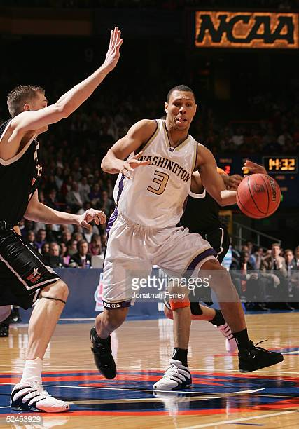 Brandon Roy of the Washington Huskies drives with the ball against the Pacific Tigers defense during the 2005 NCAA division 1 men's basketball...