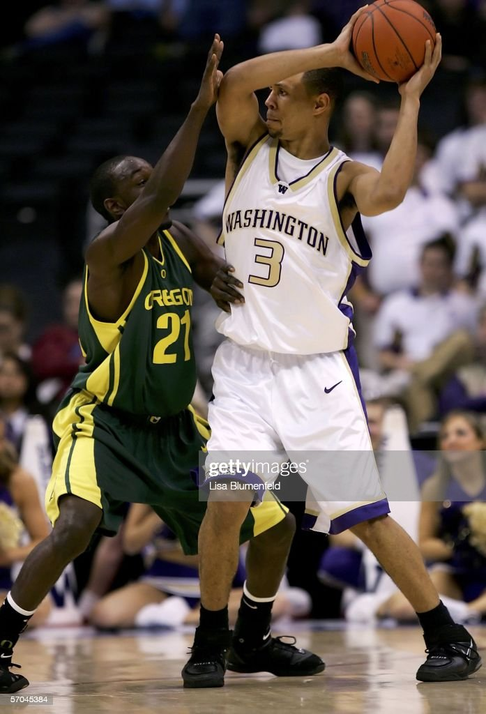 Brandon Roy #3 of the Washington Huskies looks for an open pass over Adrian Stelly #21 of the Oregon Ducks during the quarterfinals of the 2006 Pacific Life Pac-10 Men's Basketball Tournament on March 9, 2006 at Staples Center in Los Angeles, California.