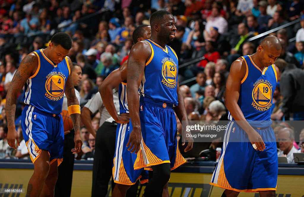 Brandon Rush #4, Draymond Green #23 and Leandro Barbosa #19 of the Golden State Warriors head to the bench for a timeout against the Denver Nuggets at Pepsi Center on March 13, 2015 in Denver, Colorado. The Nuggets defeated the Warriors 114-103.
