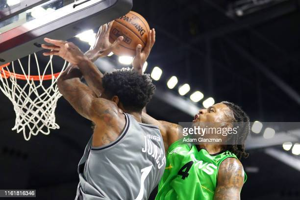 Brandon Rush of the Aliens battles for the ball with Perry Jones III of the Enemies during week four of the BIG3 three on three basketball league at...