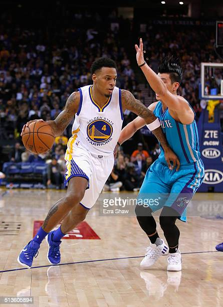 Brandon Rush of the Golden State Warriors drives on Jeremy Lin of the Charlotte Hornets at ORACLE Arena on January 4 2016 in Oakland California NOTE...