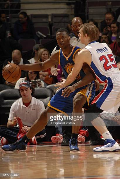Brandon Rush of the Golden State Warriors drives to the basket against Kyle Singler of the Detroit Pistons on December 5 2012 at The Palace of Auburn...