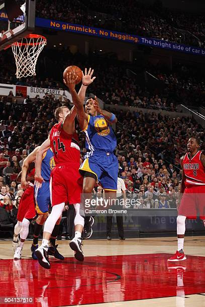 Brandon Rush of the Golden State Warriors goes to the basket against Mason Plumlee of the Portland Trail Blazers on January 8 2016 at the Moda Center...
