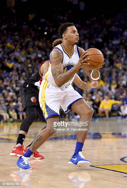 Brandon Rush of the Golden State Warriors goes up to shoot in front of Allen Crabbe of the Portland Trail Blazers during an NBA basketball game at...