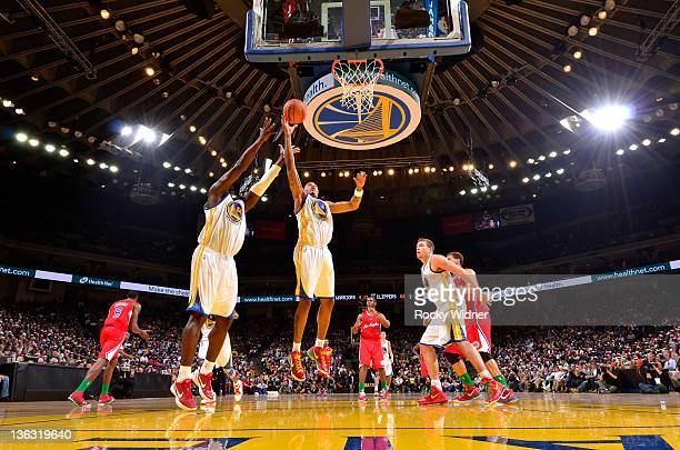 Brandon Rush of the Golden State Warriors grabs the rebound during the season opener against the Los Angeles Clippers on December 25 2011 at Oracle...