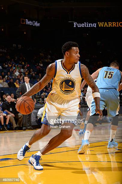 Brandon Rush of the Golden State Warriors handles the ball against the Denver Nuggets during a preseason game on October 13 2015 at ORACLE Arena in...