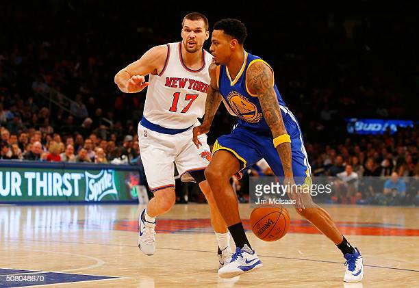 Brandon Rush of the Golden State Warriors in action against Lou Amundson of the New York Knicks at Madison Square Garden on January 31 2016 in New...