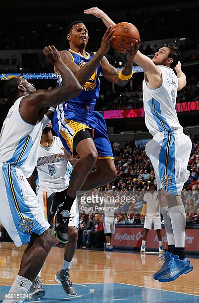 Brandon Rush of the Golden State Warriors lays up a shot against J.J. Hickson and Danilo Gallinari of the Denver Nuggets at Pepsi Center on March 13,...