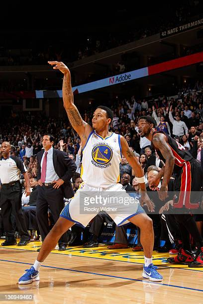 Brandon Rush of the Golden State Warriors poses after attempting a shot against the Miami Heat on January 10 2012 at Oracle Arena in Oakland...