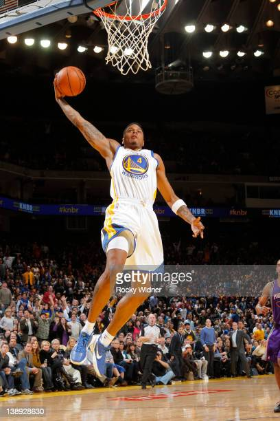 Brandon Rush of the Golden State Warriors rises up for a dunk against the Phoenix Suns on February 13 2012 at Oracle Arena in Oakland California NOTE...