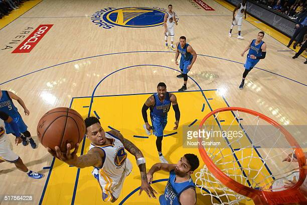 Brandon Rush of the Golden State Warriors shoots a layup againts Zaza Pachulia of the Dallas Mavericks on March 25 2016 at Oracle Arena in Oakland...