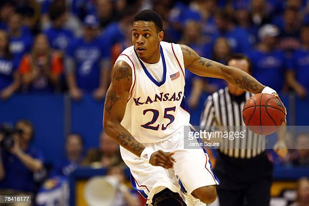 Brandon Rush of the Kansas Jayhawks dribbles the ball during the game against the Eastern Washington Eagles on December 5, 2007 at Allen Fieldhouse...