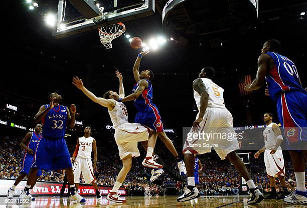 Brandon Rush of the Kansas Jayhawks shoots over Connor Atchley of the Texas Longhorns during the Big 12 Men's Basketball Tournament Finals on March...