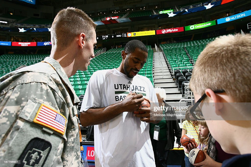 Brandon Rush #25 of the Utah Jazz signs autographs before the game against the Denver Nuggets at EnergySolutions Arena on November 11, 2013 in Salt Lake City, Utah.