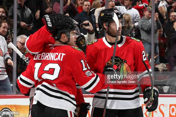 Brandon Saad and Alex DeBrincat of the Chicago Blackhawks react after DeBrincat scored against the Buffalo Sabres in the second period at the United...