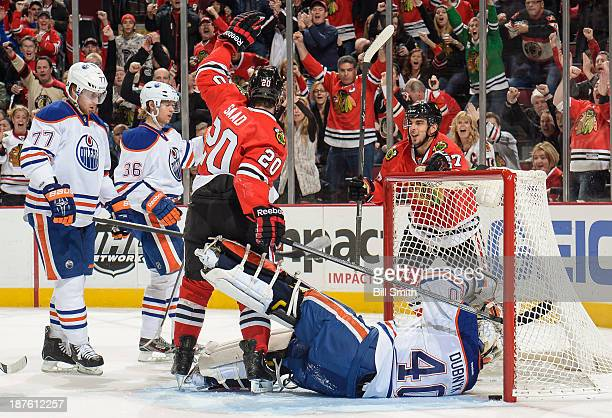Brandon Saad and Brandon Pirri of the Chicago Blackhawks react after Saad scored on goalie Devan Dubnyk of the Edmonton Oilers in the first period as...