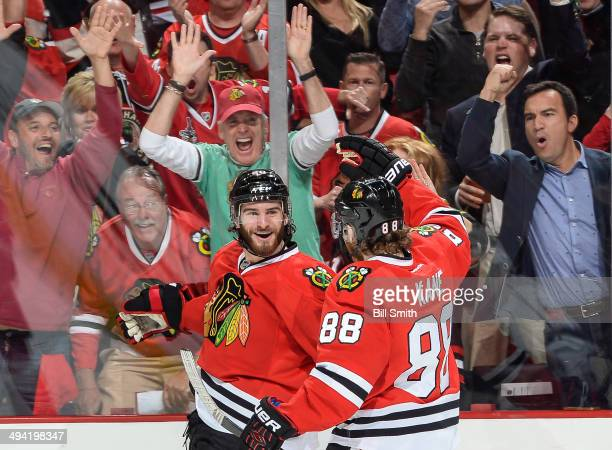 Brandon Saad and Patrick Kane of the Chicago Blackhawks celebrate after Saad scored against the Los Angeles Kings in the first period in Game Five of...