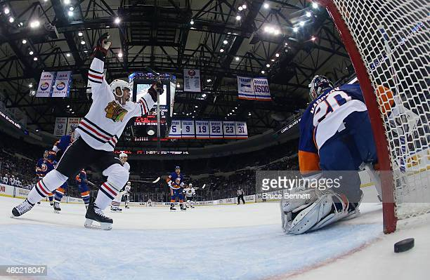 Brandon Saad celebrates a powerplay goal by Brent Seabrook of the Chicago Blackhawks at 1836 of the second period against Evgeni Nabokov of the New...