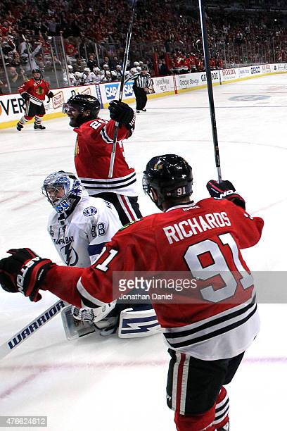 Brandon Saad celebrates with Brad Richards of the Chicago Blackhawks after scoring a goal in the third period against the Tampa Bay Lightning during...