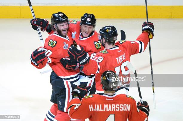 Brandon Saad Marian Hossa Jonathan Toews and Niklas Hjalmarsson of the Chicago Blackhawks celerbates after Saad scored a goal in the second period...