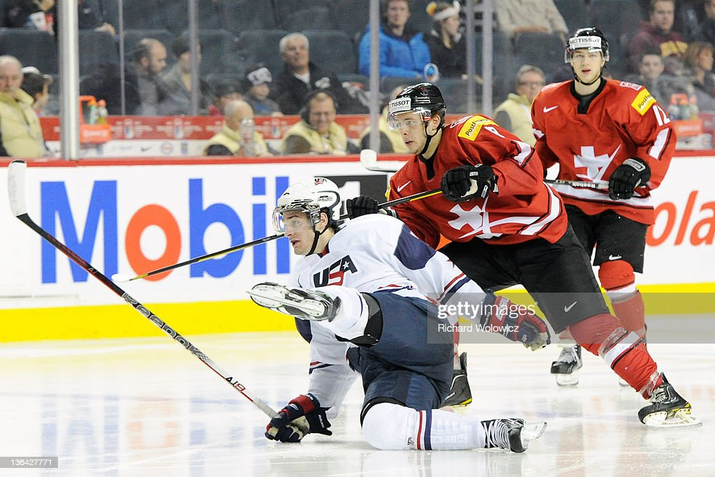 Brandon Saad #22 of Team USA collides with Dario Trutmann #17 of Team Switzerland during the 2012 World Junior Hockey Championship Relegation game at the Scotiabank Saddledome on January 4, 2012 in Calgary, Alberta, Canada. Team USA defeated Team Switzerland 2-1.