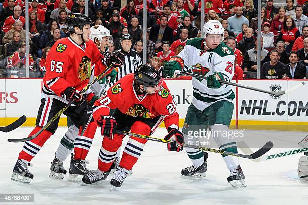 Brandon Saad of the Chicago Blackhawks and Ryan Suter of the Minnesota Wild watch for the puck in front of Andrew Shaw of the Blackhawks and Jared...
