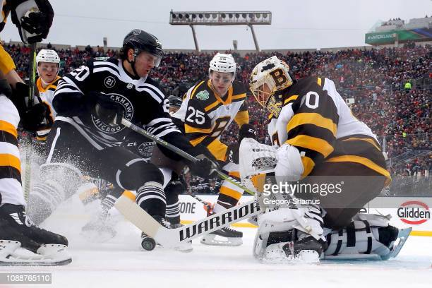 Brandon Saad of the Chicago Blackhawks attempts a shot past Tuukka Rask of the Boston Bruins in the second period during the 2019 Bridgestone NHL...