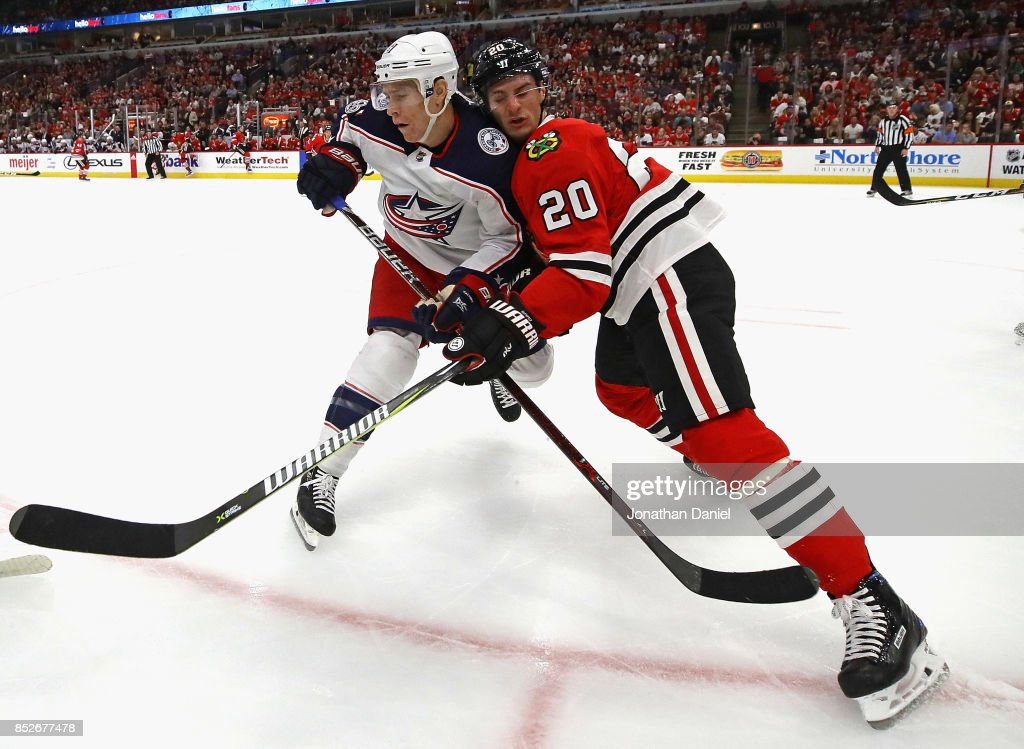 Brandon Saad #20 of the Chicago Blackhawks battles for position with Matt Calvert #11 of the Columbus Blue Jackets during a preseason game at the United Center on September 23, 2017 in Chicago, Illinois.