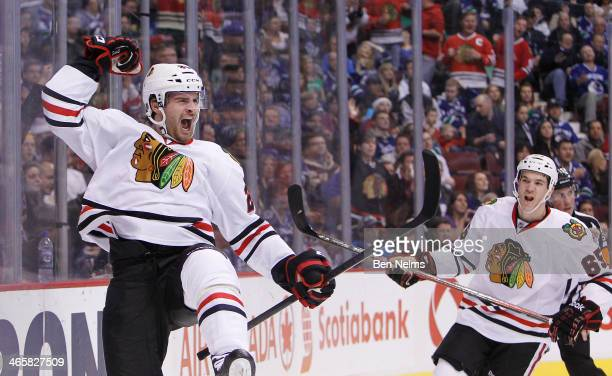 Brandon Saad of the Chicago Blackhawks celebrates his goal against the Vancouver Canucks near teammate Adrew Shaw during the second period of their...
