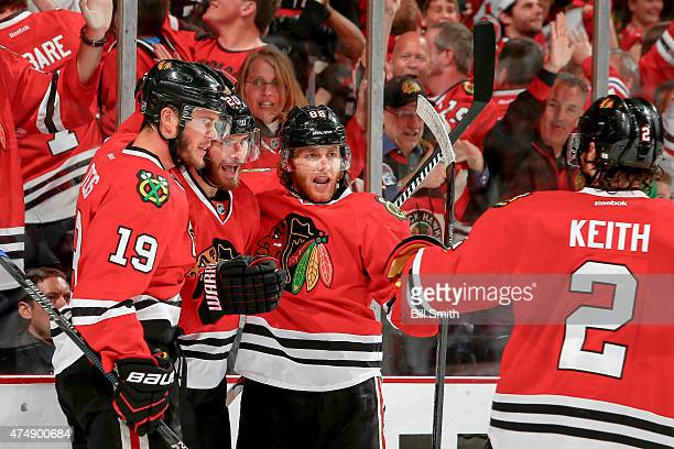 Brandon Saad of the Chicago Blackhawks celebrates with Patrick Kane and Jonathan Toews after scoring in the second period against the Anaheim Ducks...