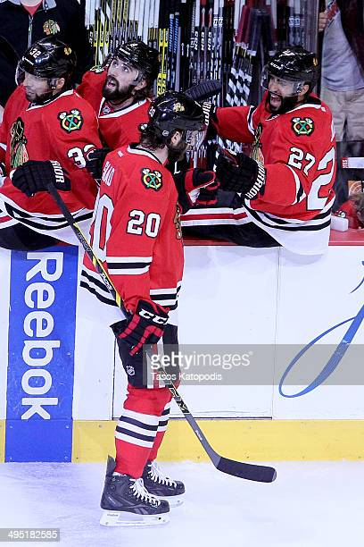 Brandon Saad of the Chicago Blackhawks celebrates with teammate Johnny Oduya after scoring a goal against Jonathan Quick of the Los Angeles Kings in...