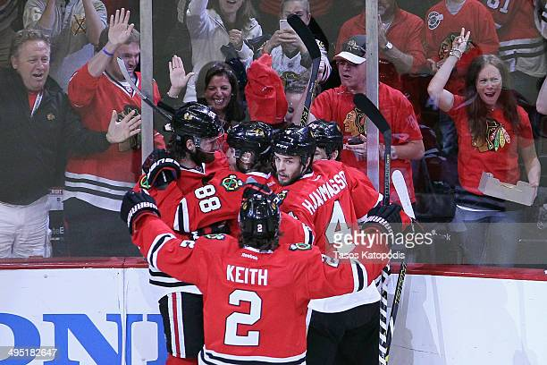 Brandon Saad of the Chicago Blackhawks celebrates with teammate Patrick Kane Duncan Keith and Niklas Hjalmarsson after scoring a goal against...