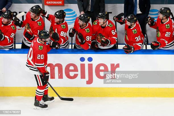 Brandon Saad of the Chicago Blackhawks celebrates with teammates after scoring a second period goal against the St. Louis Blues in an exhibition game...