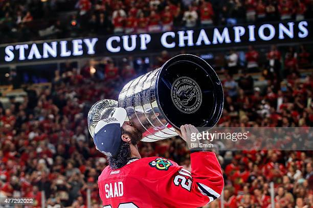 Brandon Saad of the Chicago Blackhawks celebrates with the Stanley Cup after defeating the Tampa Bay Lightning 20 in Game Six to win the 2015 NHL...